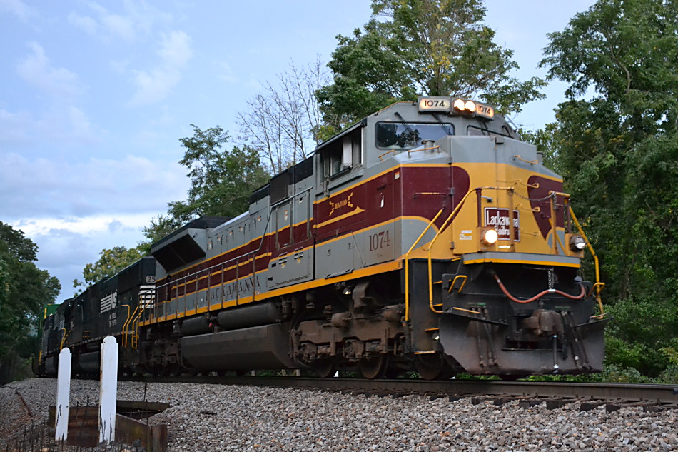 NS #1074 (Lackawanna Heritage Unit) leads train 214 westbound at Linden, Va on 8/14/2016