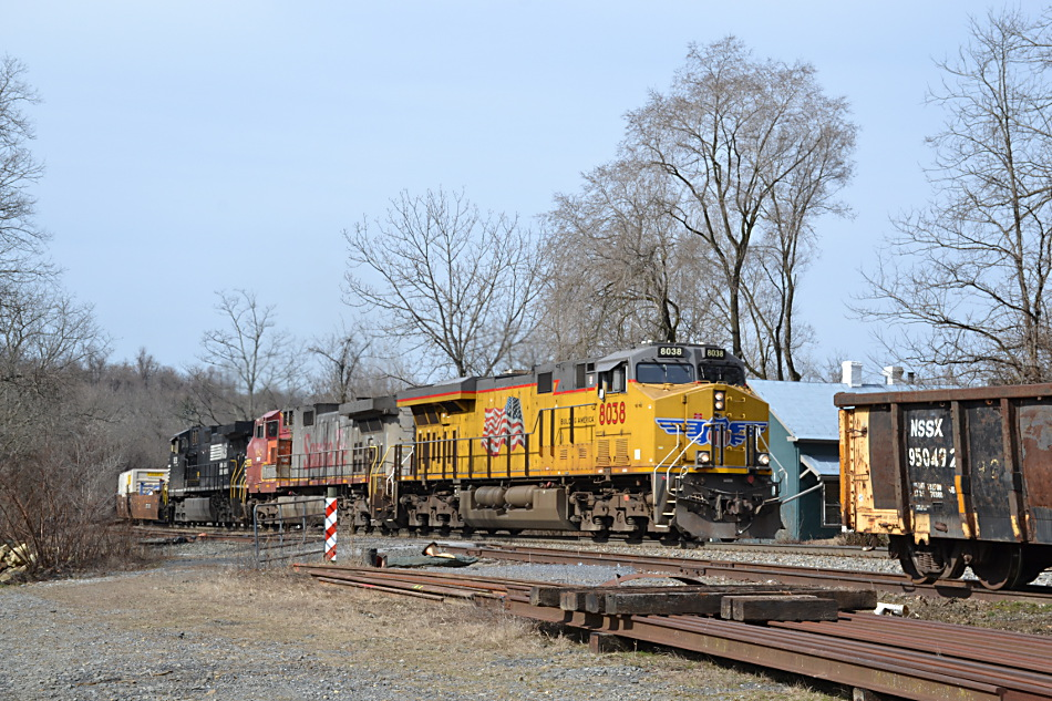 NS 211 led by UP ES44AC #8038, BNSF D9-44CW #682  and NS D9-44CW #9639 east by Linden, Va on 2/21/2017.