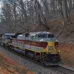 SD70ACe #1074, the Delaware Lackawanna & Western heritage unit , leads NS train 290 west up Linden Hill on 2/20/2017
