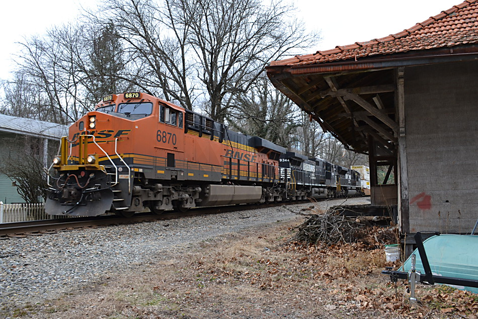 NS train 211 is led by BNSF ES44C4 #6870, NS D9-44CW #9344, and NS SD70M-2 #2656 past the old Southern Railway depot at Markham, Va  on 2/16/2017