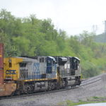 """Clear Woods"" - NS 228 heads east on the B-line in Front Royal, Va led by SD70ACe #1004 and CSX AC4400CW #376 on 4/22/2017."