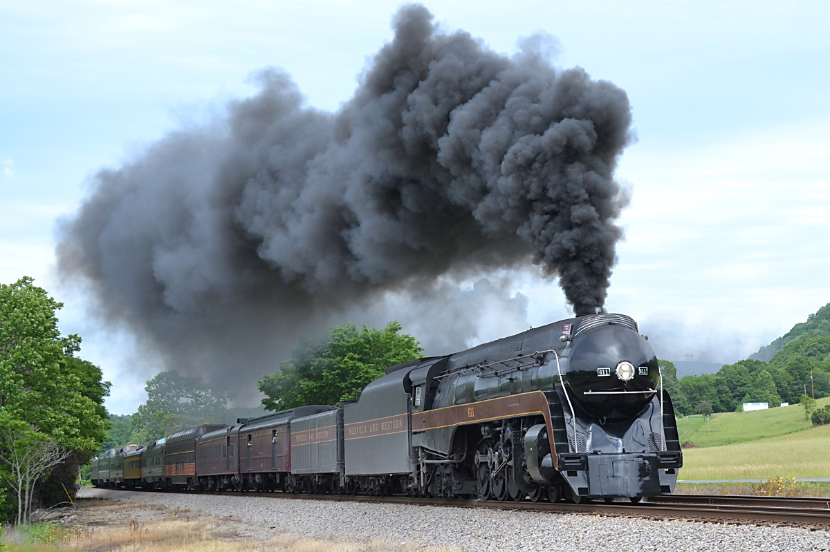 N&W Class J #611 leads NS train 957 westward at Lafayette, Virginia on the NS Christiansburg District during a Roanoke to Walton, Virginia round trip excursion on 5/29/2017.