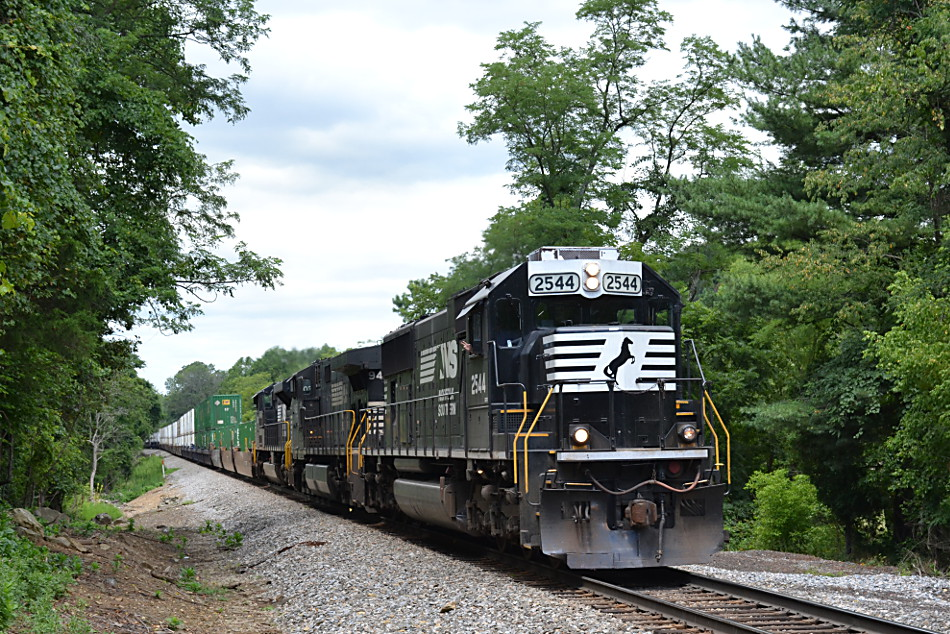 NS SD70 #2544 leads train 211 east through Linden, Va on 7/25/2017.