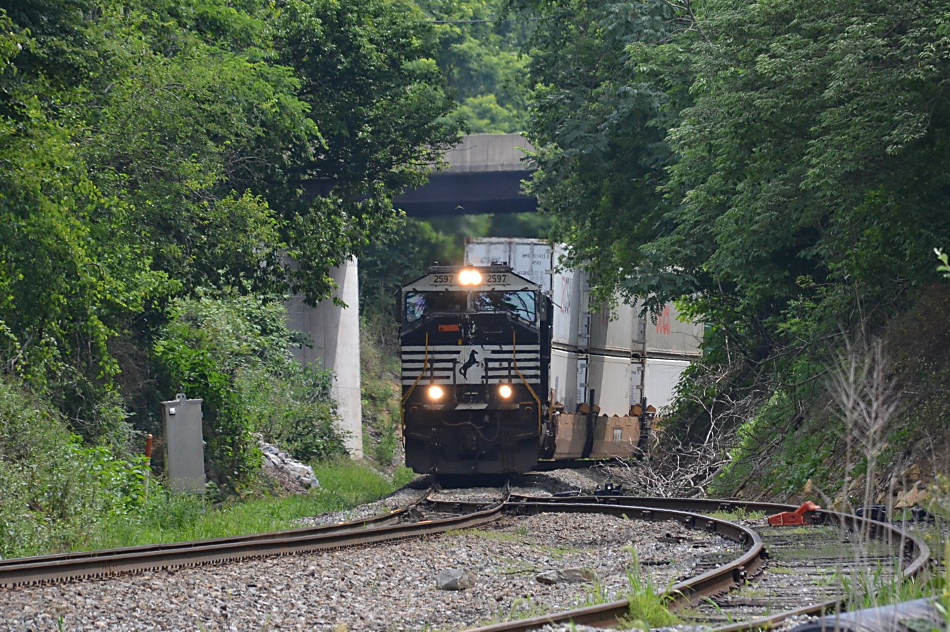 NS train 227 is led by SD70M #2597 as it crests Linden Hill in Virginia on 7/13/2017.