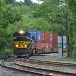NS train 228 is led by SD70ACe #1068 east at Linden, Va on 7/22/2017.