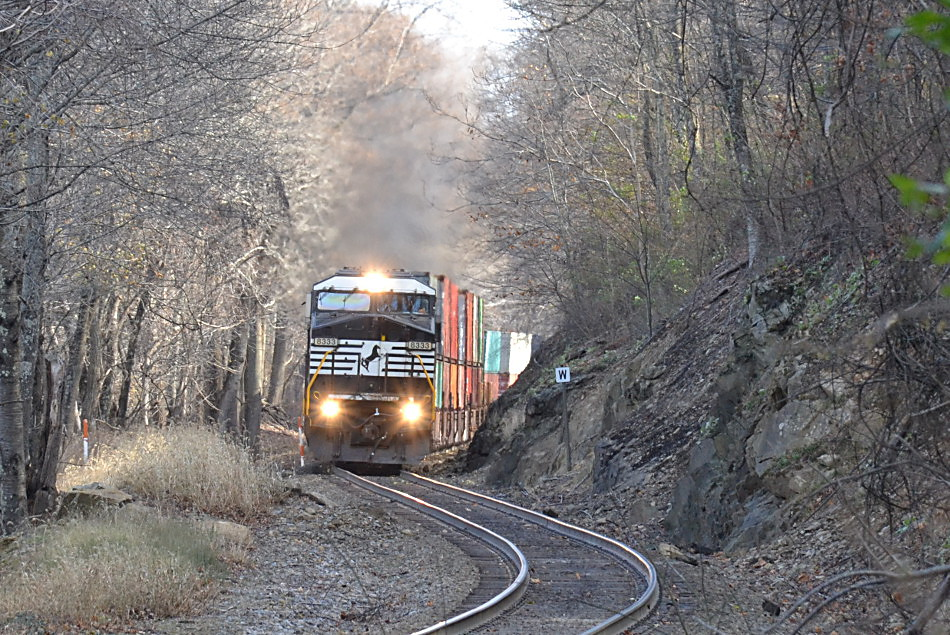 NS train 227 is led by NS D9-40CW #8333 up Linden Hill on 11/22/2017.
