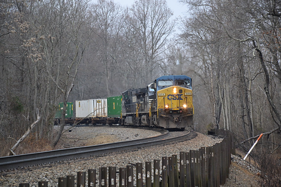 CSX AC4400CW #374 leads NS train 211 east near Linden, Virginia on 12/27/2017.