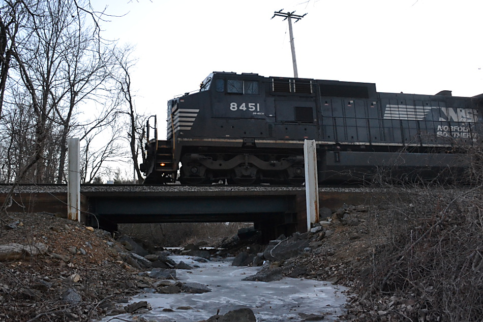 NS train 203 is led by NS (Ex-Conrail) D8-40CW #8451 east over a frozen stream in Linden, Va on 1/6/2018.