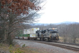 NS train 211 is led by NS D8-40CW #8461 east near Front Royal, Va on 1/12/2018.