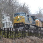 CSX C40-8W #7753 leads NS train 211 east through Markham, Va on 3/27/2018.