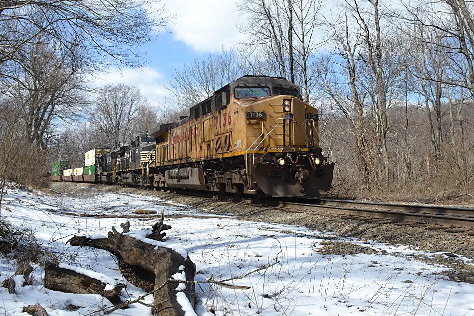 Union Pacific AC4400CW #7136 leads NS train 211 east past the Appalachian Trail in Linden, Virginia on 3/23/2018.