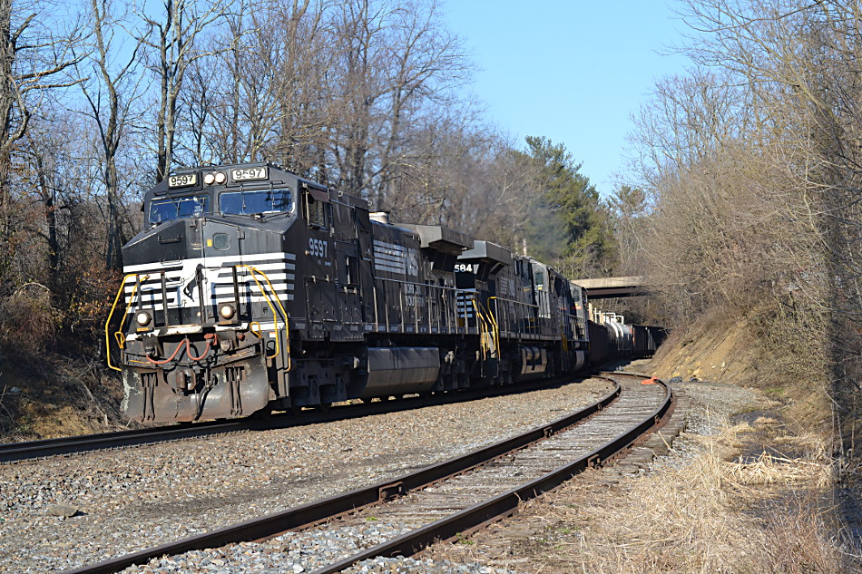 NS D9-44CW #9597 is leading the combined train of NS 12R and NS 214 over Linden Hill in Virginia on 3/10/2018.