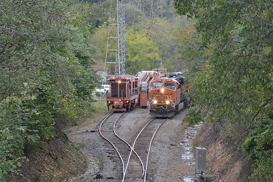 NS train 211 passes a MoW train at the top of Linden Hill in Virginia on 10/10/2018.