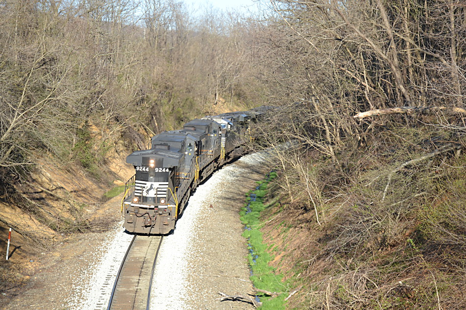 NS D9-44CW #9244 running long hood forward leads NS train 12R over Linden Hill on 4/3/2019.