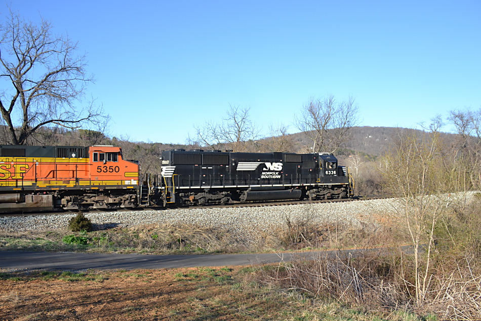 Norfolk Southern train 211 was led by NS SD40E #6336 with BNSF power trailing near Linden, VA on 4/3/2019.