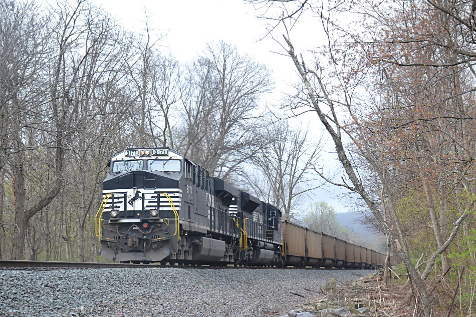 DPUs NS SD70ACe #1179 and ES-44AC #8171 push on the rear of NS train 740 (loaded coal train) in Linden, VA on 4/12/2019.