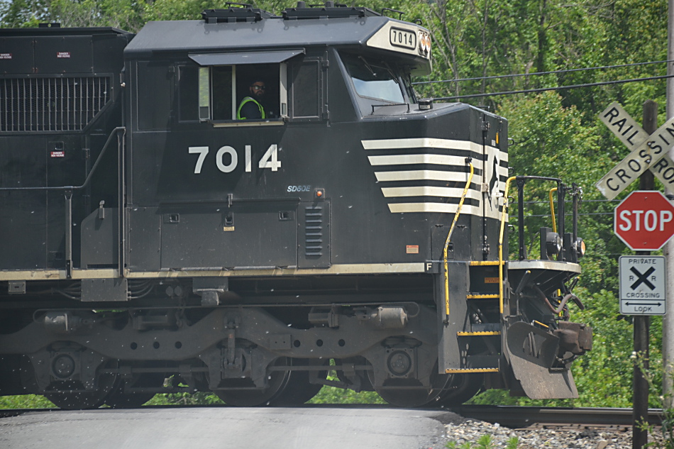 Led by Norfolk Southern SD60E #7014, NS train 13R passes the CCC Road crossing in Linden, Virginia on 5/23/2019.