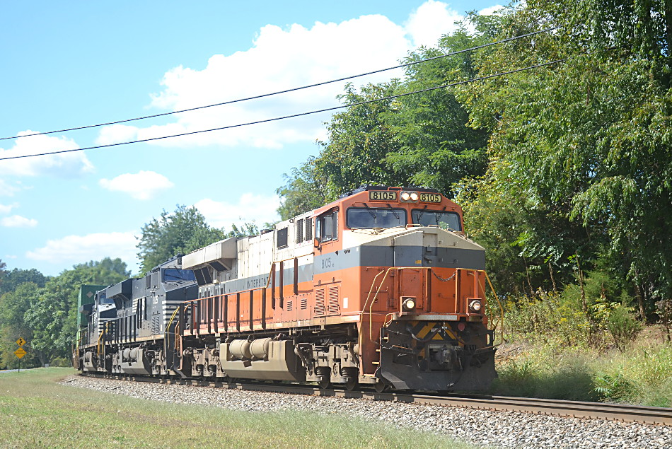 211 is led by a pair of NS ES-44ACs (#8105 & #8125) along with D9-44CW #9344 east near the control point at Woods in Front Royal, VA on 9/18/2019.