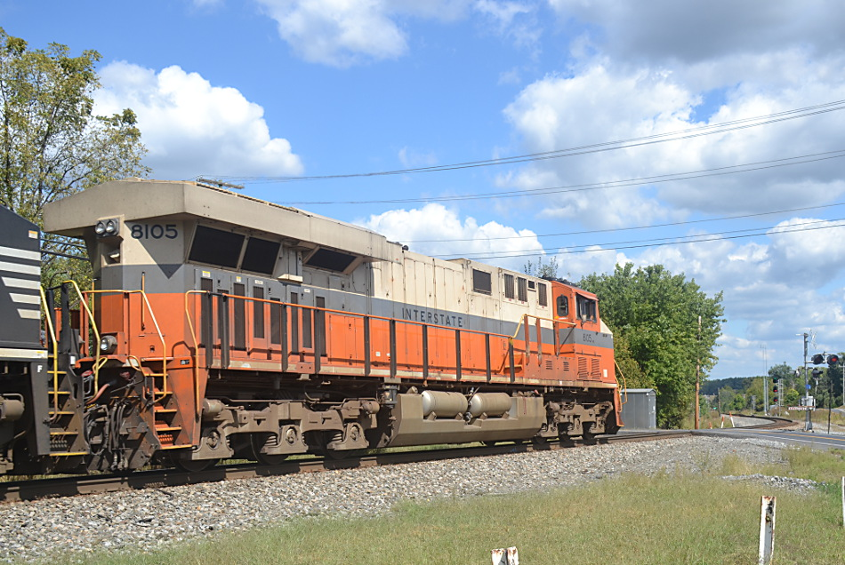 With the Interstate Railroad heritage unit leading the way, NS train 211 has a clear signal east on the mainline at Woods on 9/18/2019.