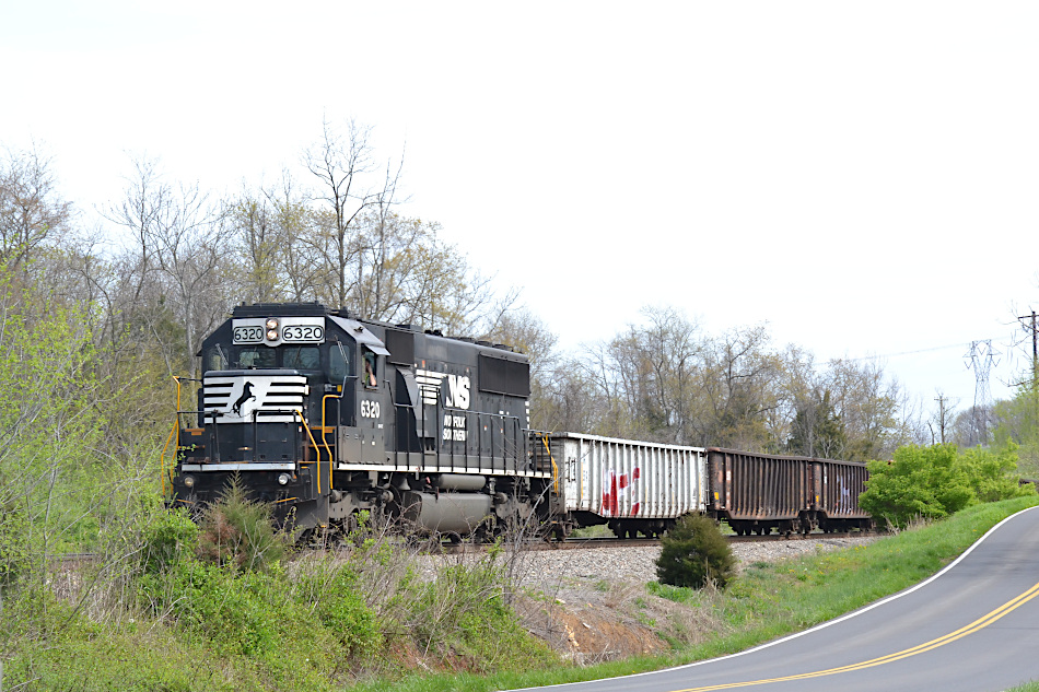 On 4/7/2020, NS SD40-2 #6320 leads train 92Q.  They are stopped for eastbound traffic, waiting on the siding at the control point at Woods.