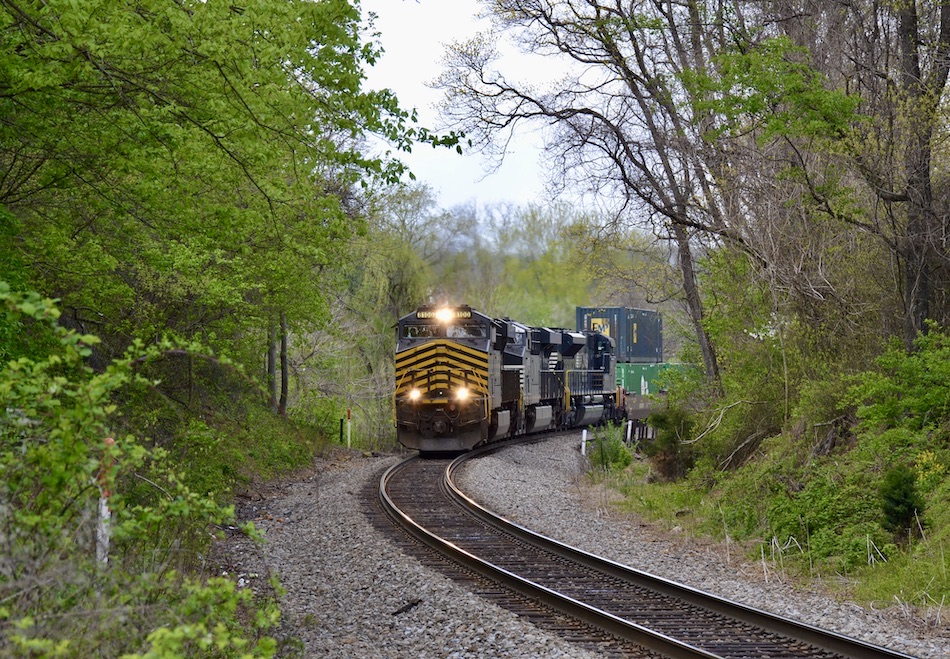 NS train 211 led by the Nickel Plate Road heritage unit nears Linden, Virginia on 4/22/2021.