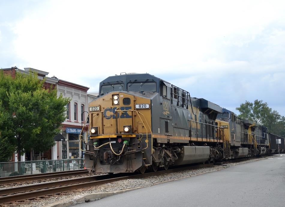 Southbound CSX hopper train led by ES44AH #820 passing through Ashland, Virginia on August 22, 2021